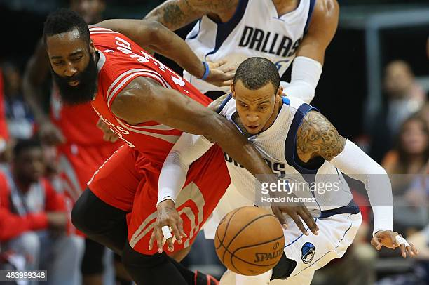 James Harden of the Houston Rockets challenges Monta Ellis of the Dallas Mavericks at American Airlines Center on February 20 2015 in Dallas Texas...