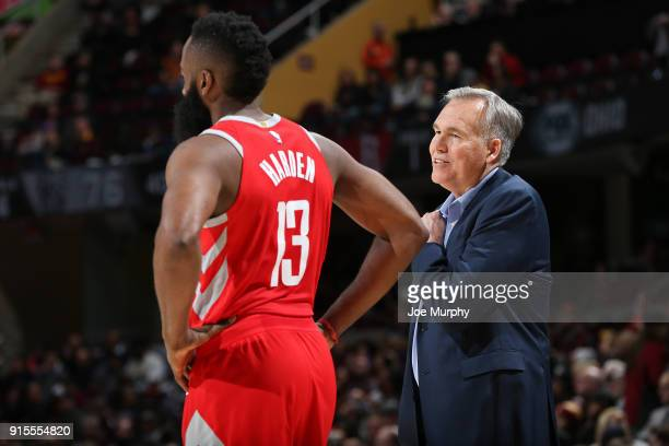 James Harden of the Houston Rockets chats with Head Coach Mike D'Antoni of the Houston Rockets during the game against the Cleveland Cavaliers on...