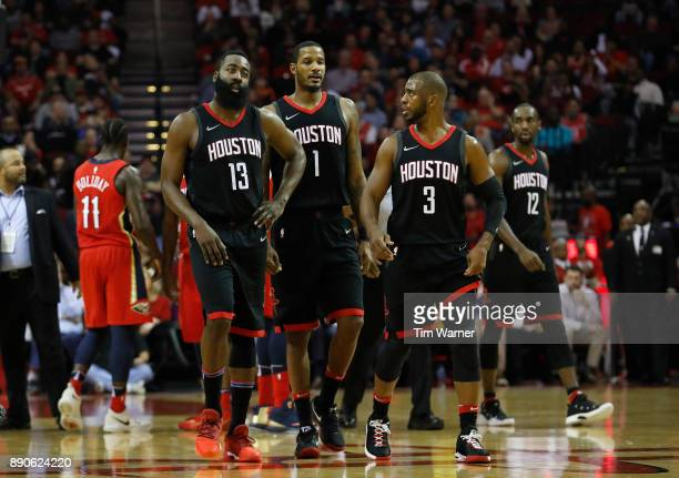 James Harden of the Houston Rockets Chris Paul and Trevor Ariza react after a techical foul in the first half against the New Orleans Pelicans at...