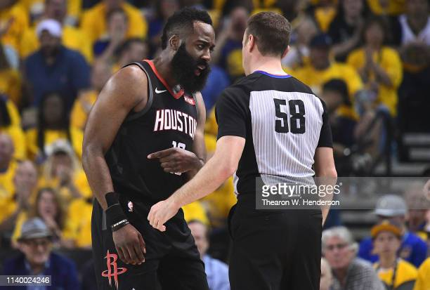 James Harden of the Houston Rockets complains over a foul call on him against the Golden State Warriors to referee Josh Tiven during Game One of the...