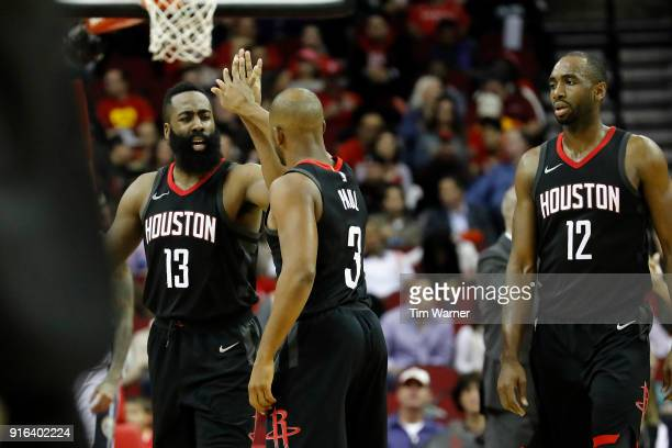 James Harden of the Houston Rockets congratulates Chris Paul after a three point shot in the second half against the Denver Nuggets at Toyota Center...