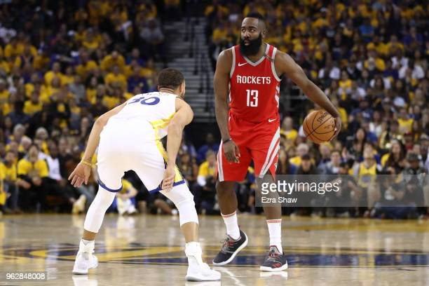 James Harden of the Houston Rockets controls the ball against Stephen Curry of the Golden State Warriors during Game Six of the Western Conference...