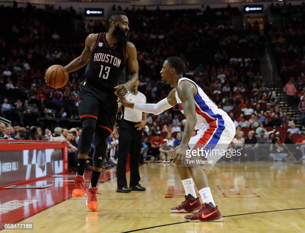 James Harden of the Houston Rockets controls the ball defended by Kentavious CaldwellPope of the Detroit Pistons in the first half at Toyota Center...