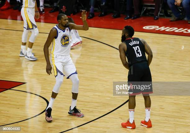 James Harden of the Houston Rockets controls the ball defended by Kevin Durant of the Golden State Warriors in the first half during Game Two of the...