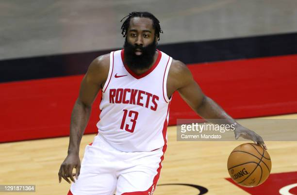 James Harden of the Houston Rockets controls the ball during the first half of a game against the San Antonio Spurs at the Toyota Center on December...