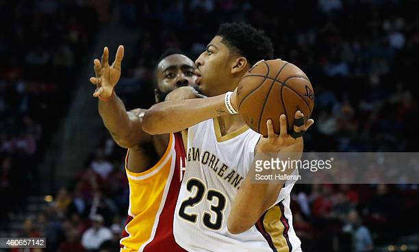 HOUSTON TX DECEMBER18 James Harden of the Houston Rockets defends against Anthony Davis of the New Orleans Pelicans during their game at the Toyota...