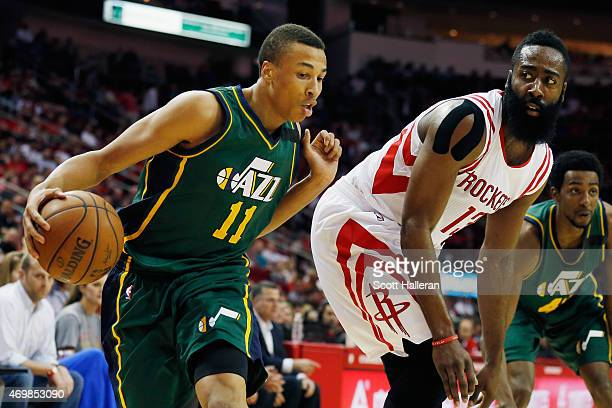 James Harden of the Houston Rockets defends against Dante Exum of the Utah Jazz during their game at the Toyota Center on April 15 2015 in Houston...