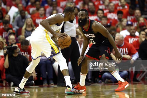 James Harden of the Houston Rockets defends Kevin Durant of the Golden State Warriors in the first half in Game One of the Western Conference Finals...