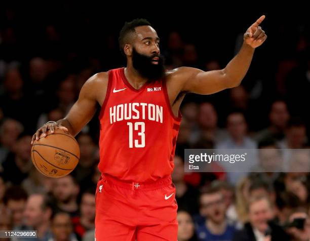 James Harden of the Houston Rockets directs his teammates in the first quarter against the New York Knicks at Madison Square Garden on January 23...