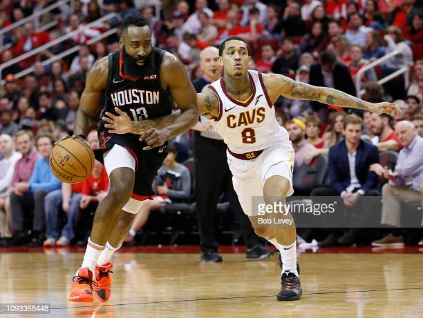 James Harden of the Houston Rockets dribble drives past Jordan Clarkson of the Cleveland Cavaliers at Toyota Center on January 11 2019 in Houston...