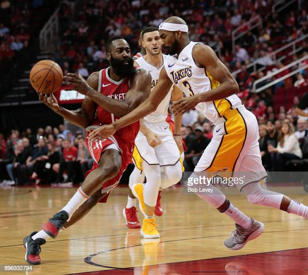 James Harden of the Houston Rockets dribbles around Corey Brewer of the Los Angeles Lakers at Toyota Center on December 20 2017 in Houston Texas NOTE...