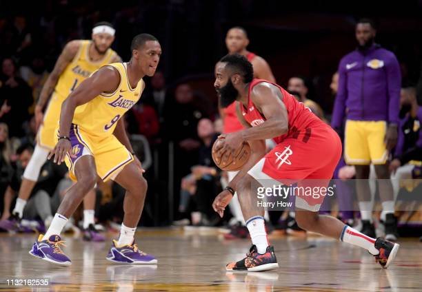 James Harden of the Houston Rockets dribbles in front of Rajon Rondo of the Los Angeles Lakers during a 111106 Lakers win at Staples Center on...