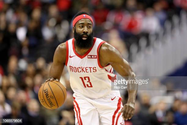 James Harden of the Houston Rockets dribbles the ball against the Washington Wizards in the first half at Capital One Arena on November 26 2018 in...