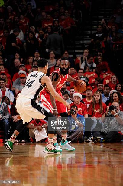 James Harden of the Houston Rockets dribbles the ball against the San Antonio Spurs on December 25 2015 at Toyota Center in HoustonTexasNOTE TO USER...