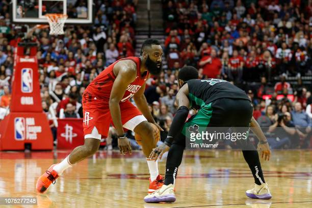James Harden of the Houston Rockets dribbles the ball defended by Kyrie Irving of the Boston Celtics in the second half at Toyota Center on December...