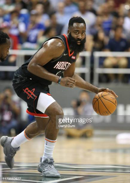 James Harden of the Houston Rockets dribbles the ball during the first half of the game against the Los Angeles Clippers at the Stan Sheriff Center...