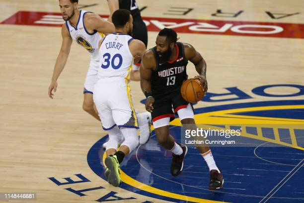 James Harden of the Houston Rockets dribbles the ball up court against the Golden State Warriors during Game Five of the Western Conference...