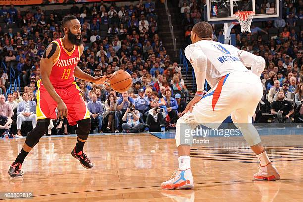 James Harden of the Houston Rockets dribbles the ball while defended by Russell Westbrook of the Oklahoma City Thunder on April 5 2015 at Chesapeake...