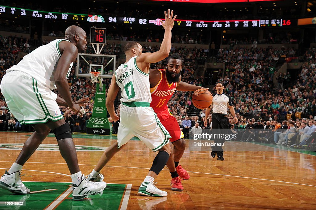 James Harden #13 of the Houston Rockets drives against Avery Bradley #0 of the Boston Celtics on January 11, 2013 at the TD Garden in Boston, Massachusetts.