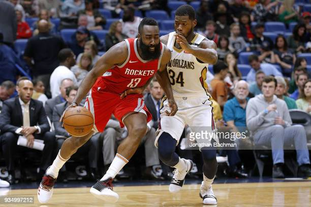 James Harden of the Houston Rockets drives against DeAndre Liggins of the New Orleans Pelicans during the second half at the Smoothie King Center on...