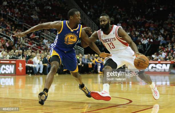 James Harden of the Houston Rockets drives against Harrison Barnes of the Golden State Warriors during the game at Toyota Center on December 6 2013...