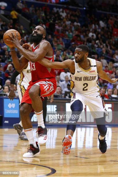 James Harden of the Houston Rockets drives against Ian Clark of the New Orleans Pelicans during the second half at the Smoothie King Center on March...
