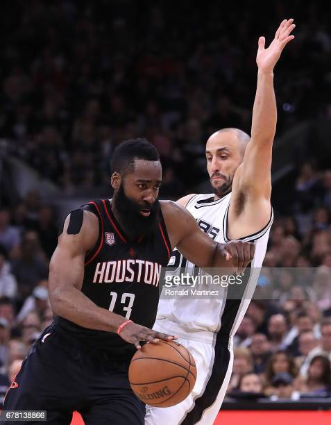 James Harden of the Houston Rockets drives against Manu Ginobili of the San Antonio Spurs during Game Two of the NBA Western Conference SemiFinals at...