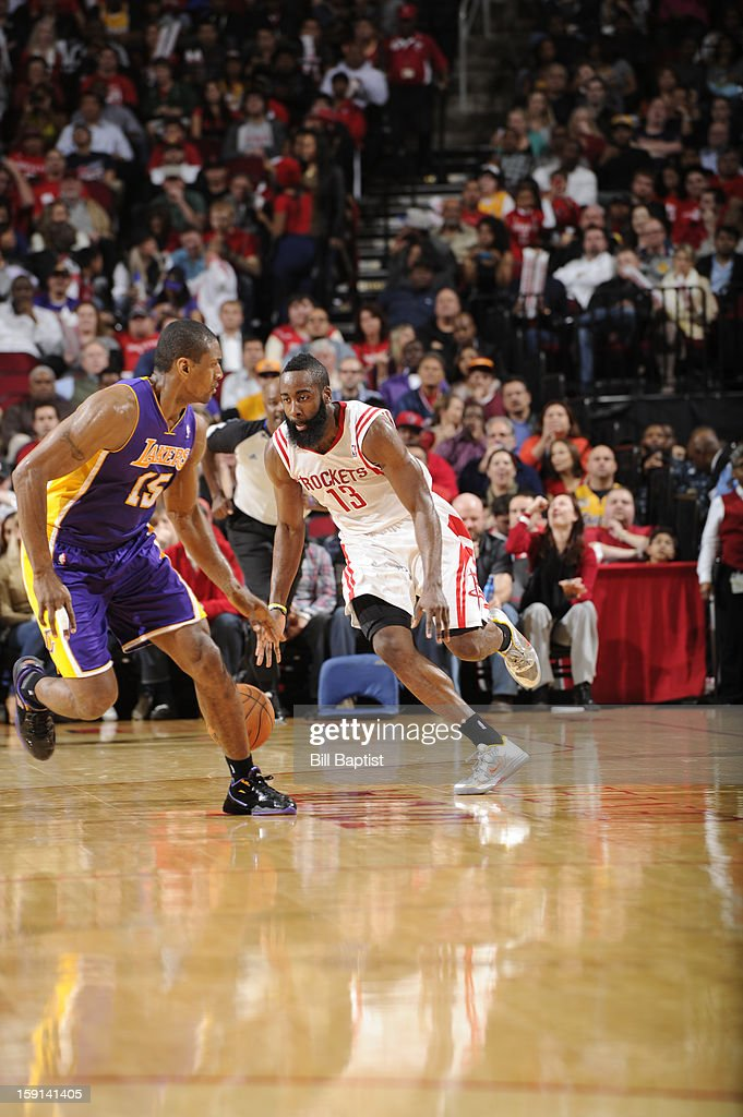 4f7ae5a9c5b James Harden of the Houston Rockets drives against Metta World Peace ...