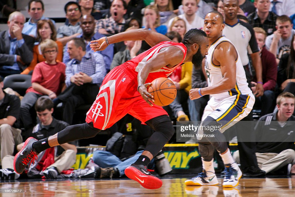 James Harden #13 of the Houston Rockets drives against Randy Foye #8 of the Utah Jazz at Energy Solutions Arena on November 19, 2012 in Salt Lake City, Utah.