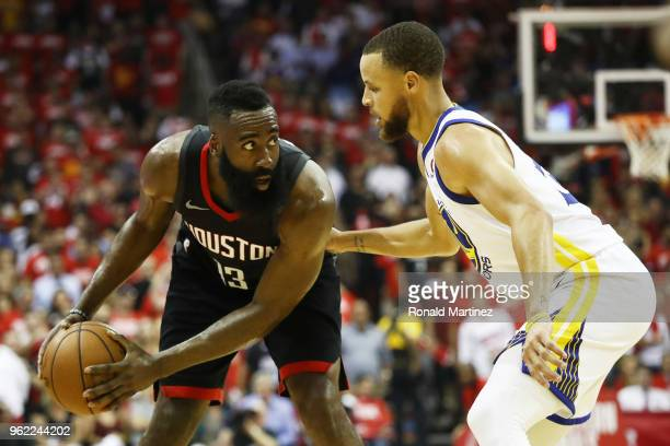 James Harden of the Houston Rockets drives against Stephen Curry of the Golden State Warriors in the first half of Game Five of the Western...