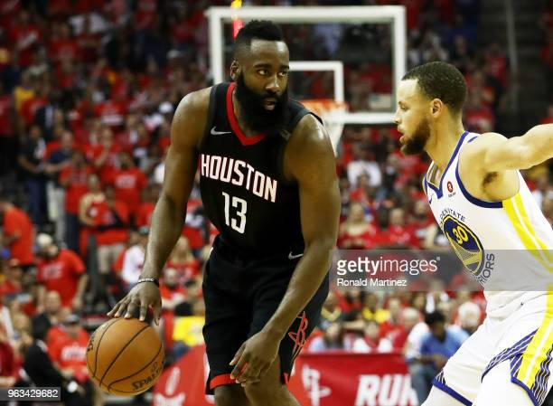 James Harden of the Houston Rockets drives against Stephen Curry of the Golden State Warriors in the first half of Game Seven of the Western...