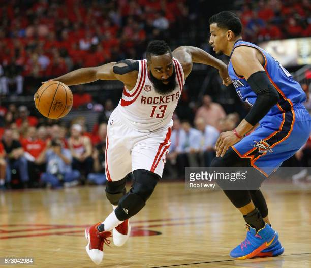 James Harden of the Houston Rockets drives around Andre Roberson of the Oklahoma City Thunder during Game Five of the Western Conference...