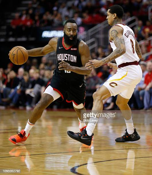 James Harden of the Houston Rockets drives around Jordan Clarkson of the Cleveland Cavaliers during the third quarter at Toyota Center on January 11...