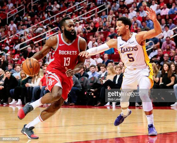 James Harden of the Houston Rockets drives around Josh Hart of the Los Angeles Lakers at Toyota Center on December 20 2017 in Houston Texas NOTE TO...