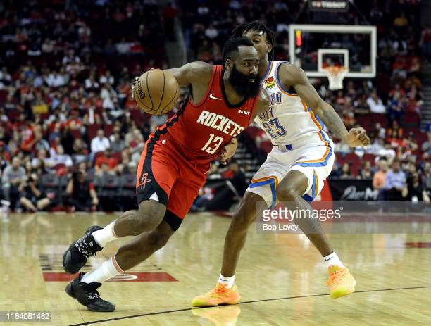 James Harden of the Houston Rockets drives around Terrance Ferguson of the Oklahoma City Thunder during the second quarter at Toyota Center on...