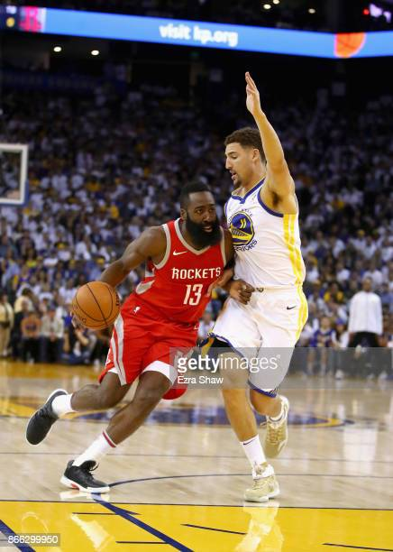 James Harden of the Houston Rockets drives on Klay Thompson of the Golden State Warriors at ORACLE Arena on October 17 2017 in Oakland California...
