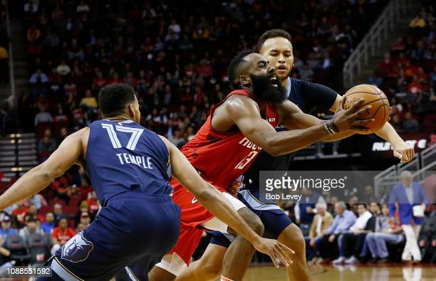 James Harden of the Houston Rockets drives past Garrett Temple of the Memphis Grizzlies during the first quarter at Toyota Center on December 31 2018...