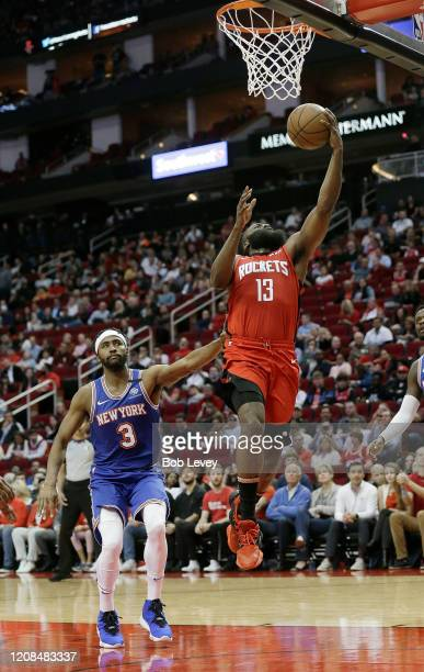 James Harden of the Houston Rockets drives past Maurice Harkless of the New York Knicks for a layup during the first quarter at Toyota Center on...