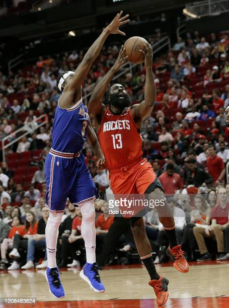 James Harden of the Houston Rockets drives past Maurice Harkless of the New York Knicks for a layup during the second quarter at Toyota Center on...