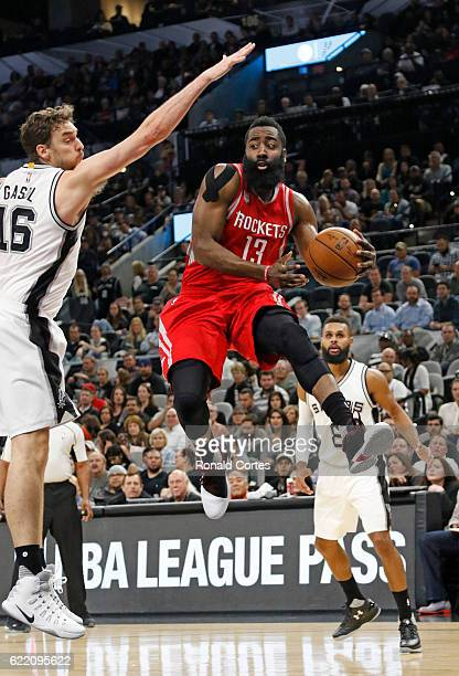 James Harden of the Houston Rockets drives past Pau Gasol of the San Antonio Spurs at ATT Center on November 9 2016 in San Antonio Texas NOTE TO USER...