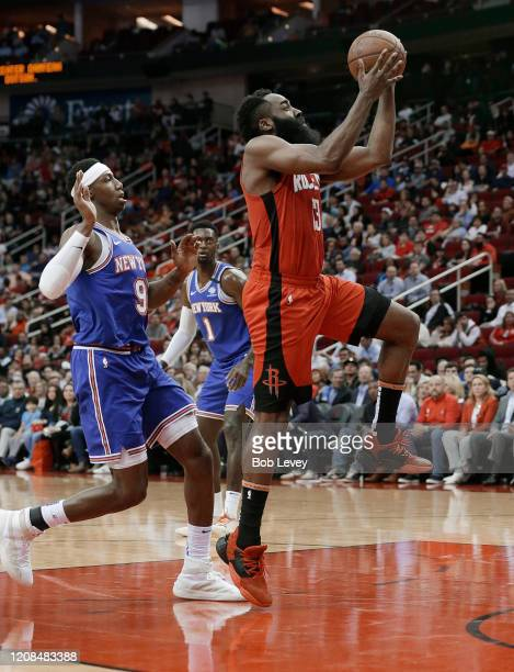 James Harden of the Houston Rockets drives past RJ Barrett of the New York Knicks for a layup during the first quarter at Toyota Center on February...