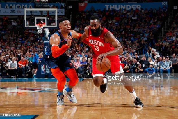 James Harden of the Houston Rockets drives past Russell Westbrook of the Oklahoma City Thunder on April 9, 2019 at Chesapeake Energy Arena in...