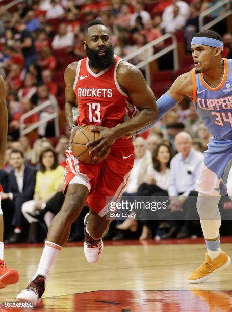 James Harden of the Houston Rockets drives past Tobias Harris of the LA Clippers at Toyota Center on March 15 2018 in Houston Texas NOTE TO USER User...