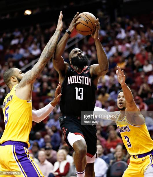 James Harden of the Houston Rockets drives to basket between Tyson Chandler of the Los Angeles Lakers nad Josh Hart during the second quarter at...