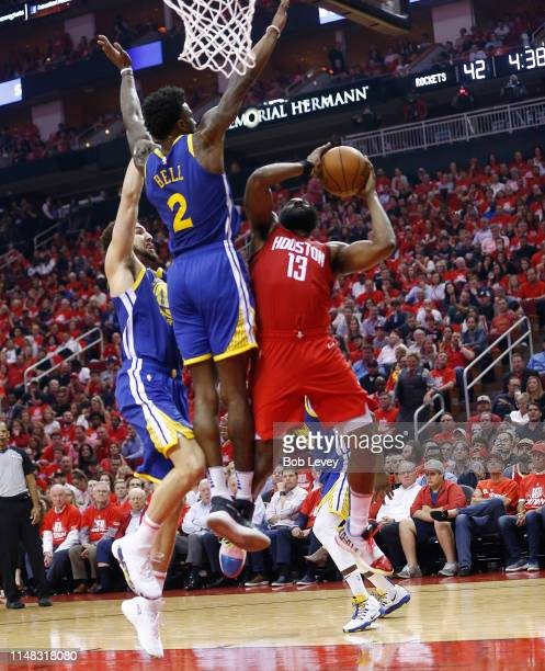 James Harden of the Houston Rockets drives to the baskeet as Jordan Bell of the Golden State Warriors and Klay Thompson defend during Game Six of the...