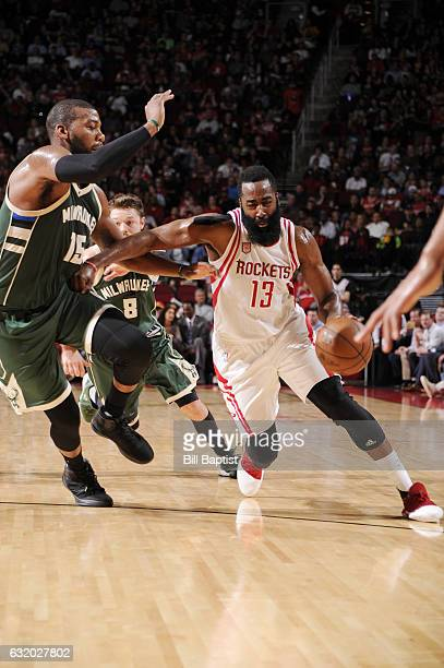 James Harden of the Houston Rockets drives to the basket against Greg Monroe of the Milwaukee Bucks during the game on January 18 2017 at the Toyota...