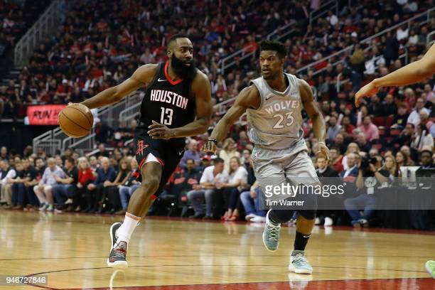 James Harden of the Houston Rockets drives to the basket against Jimmy Butler of the Minnesota Timberwolves in the first half during Game One of the...