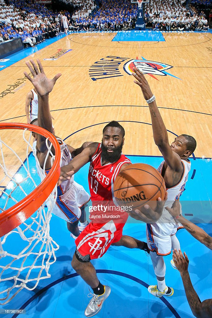 James Harden #13 of the Houston Rockets drives to the basket against Serge Ibaka #9 and Kevin Durant #35 of the Oklahoma City Thunder in Game Two of the Western Conference Quarterfinals during the 2013 NBA Playoffs on April 24, 2013 at the Chesapeake Energy Arena in Oklahoma City, Oklahoma.