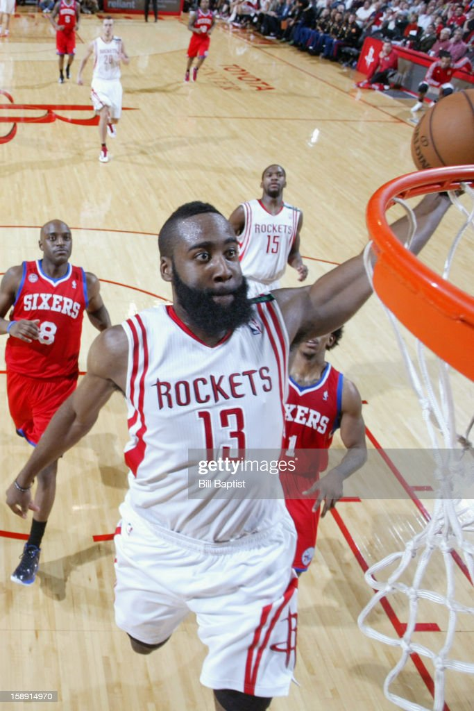 James Harden #13 of the Houston Rockets drives to the basket against the Philadelphia 76ers on December 19, 2012 at the Toyota Center in Houston, Texas.