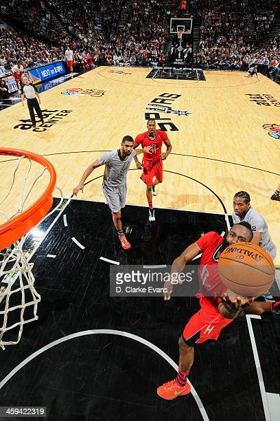 James Harden of the Houston Rockets drives to the basket against the San Antonio Spurs during the game at the ATT Center on December 25 2013 in San...